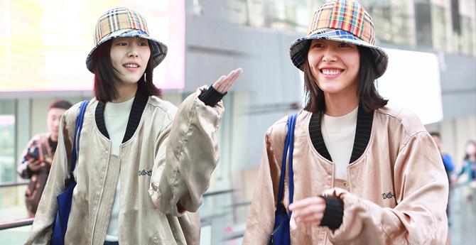 刘雯随性打扮现身机场 笑容如春风十里美到不像话