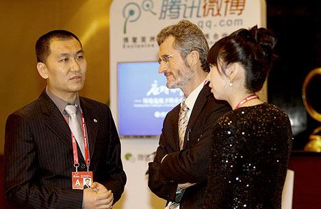 腾讯公司副总裁孙忠怀与联合国全球契约组织总干事乔治科尔